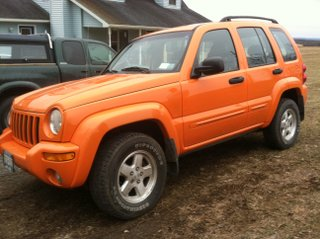 Orange Jeep Liberty